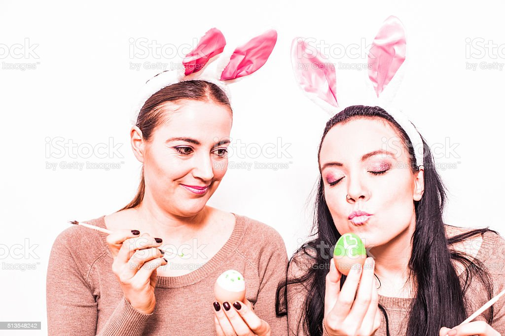 bunny girls painting easter eggs stock photo