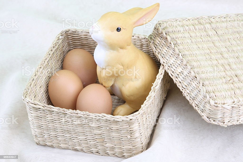 Bunny with Eggs in Basket royalty-free stock photo