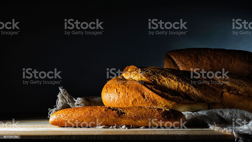 Buns and bread on a dark background. stock photo