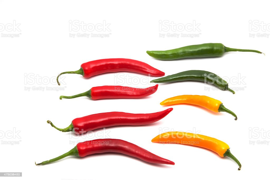 Bunte Chilis in Reihe stock photo