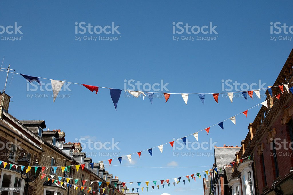 Bunting flags against blue sky stock photo