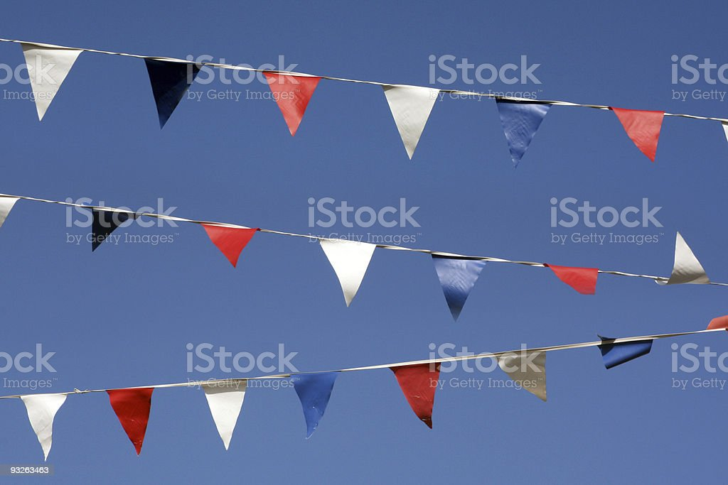 Bunting flags on blue sky royalty-free stock photo