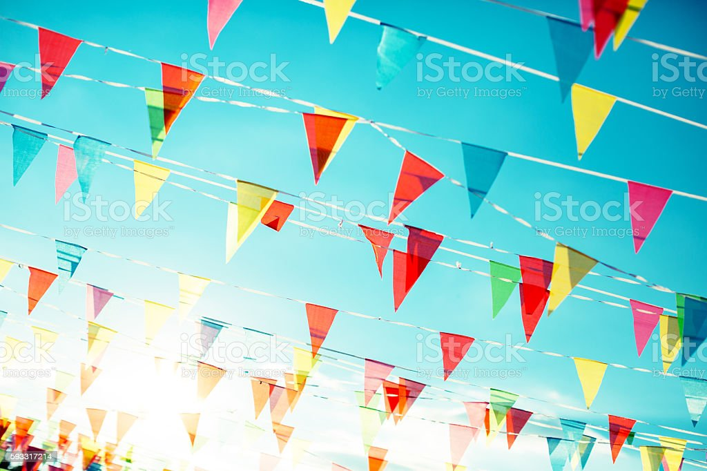 Bunting Flags on the blue sky background stock photo