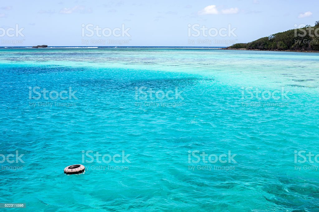 buoy in a crystal blue sea. stock photo