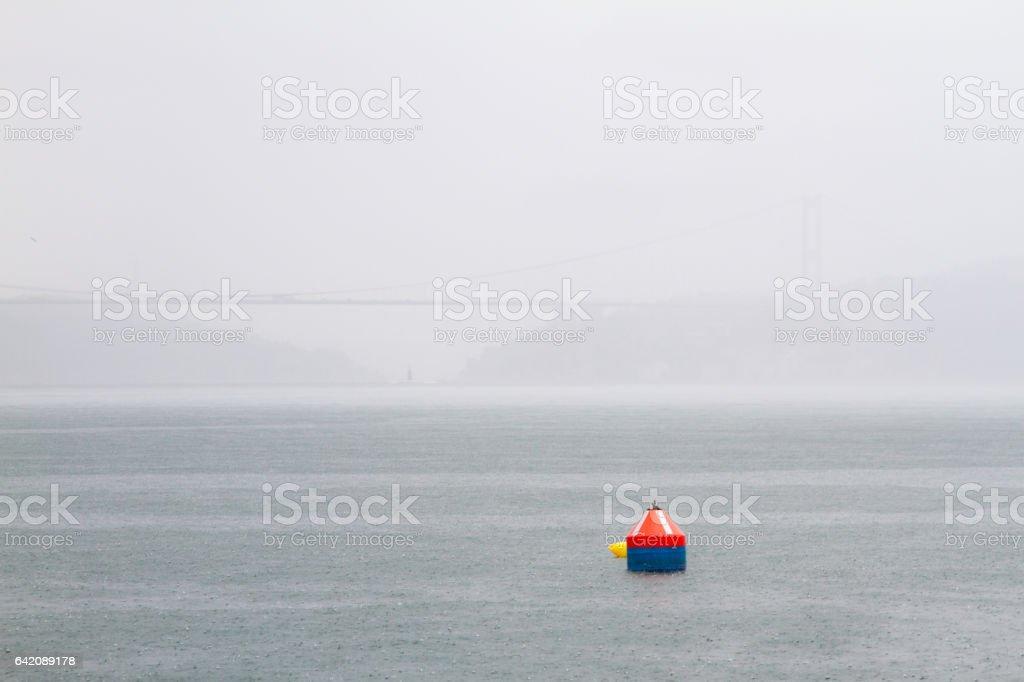 A buoy in a rainy day in Bosphorus stock photo
