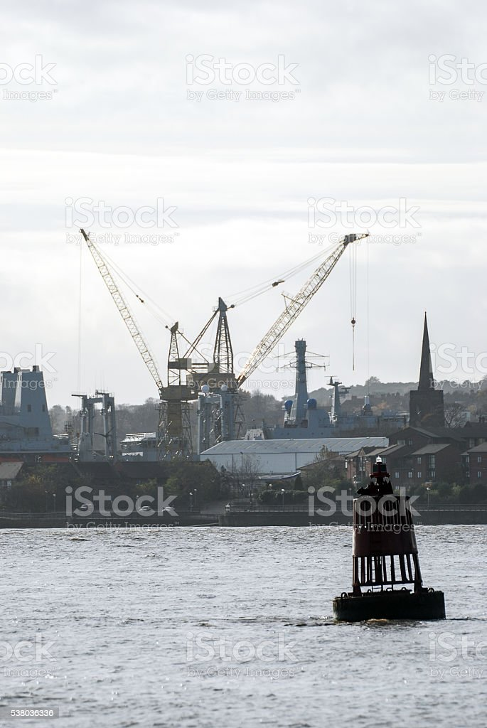 Buoy in front of birkenhead dockland area stock photo