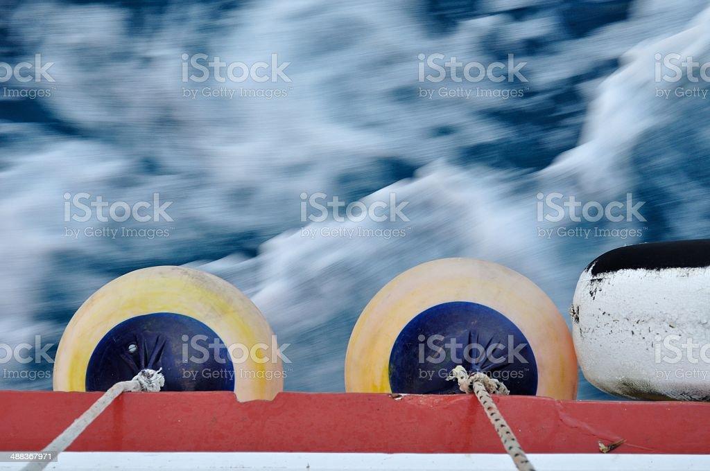 Buoy on body of moving ship royalty-free stock photo