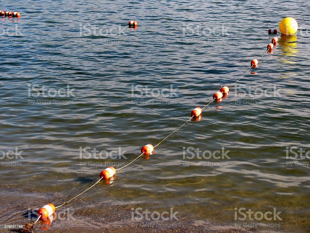 Buoy safe zone for swimming area stock photo