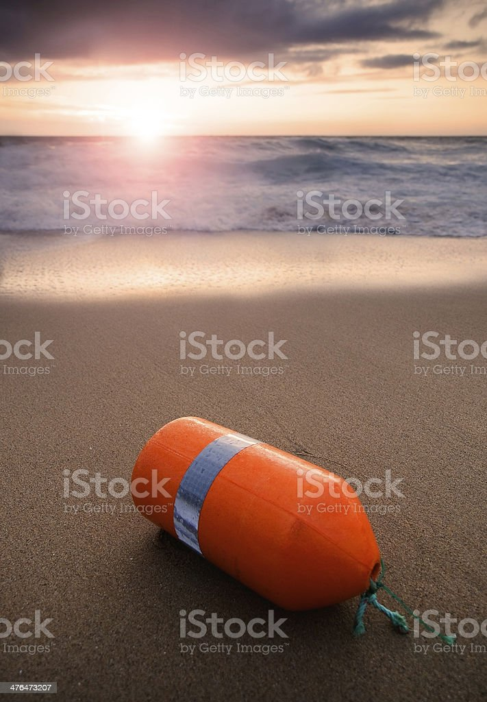 Buoy washed up on a beach royalty-free stock photo