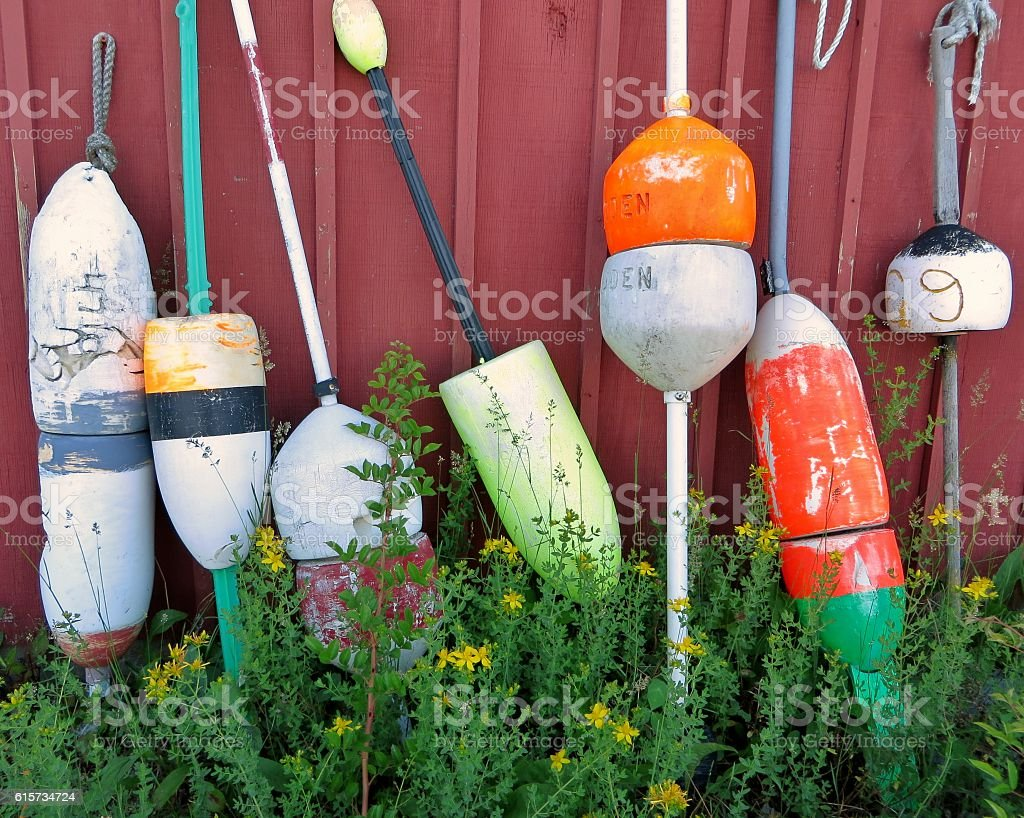 Buoys Against Red Wall stock photo