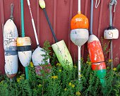 Buoys Against Red Wall