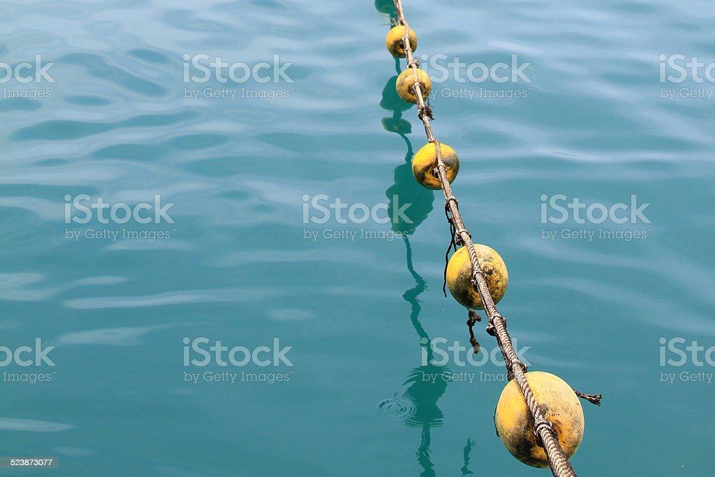 Buoys and deep blue sea stock photo
