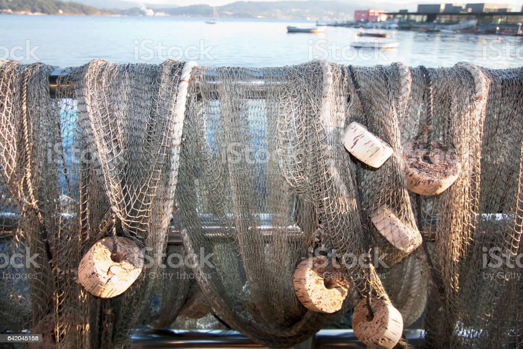 Buoys and fishing nets hanging to dry by the sea, Combarro, Galicia, Spain. stock photo