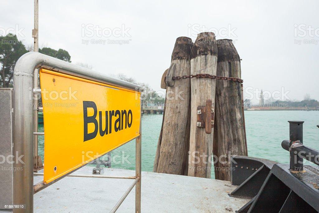 Burano signboard on waterbus stop stock photo