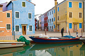 Burano, Venice: Senior Man Moors Fishing Boat Near Colorful Homes