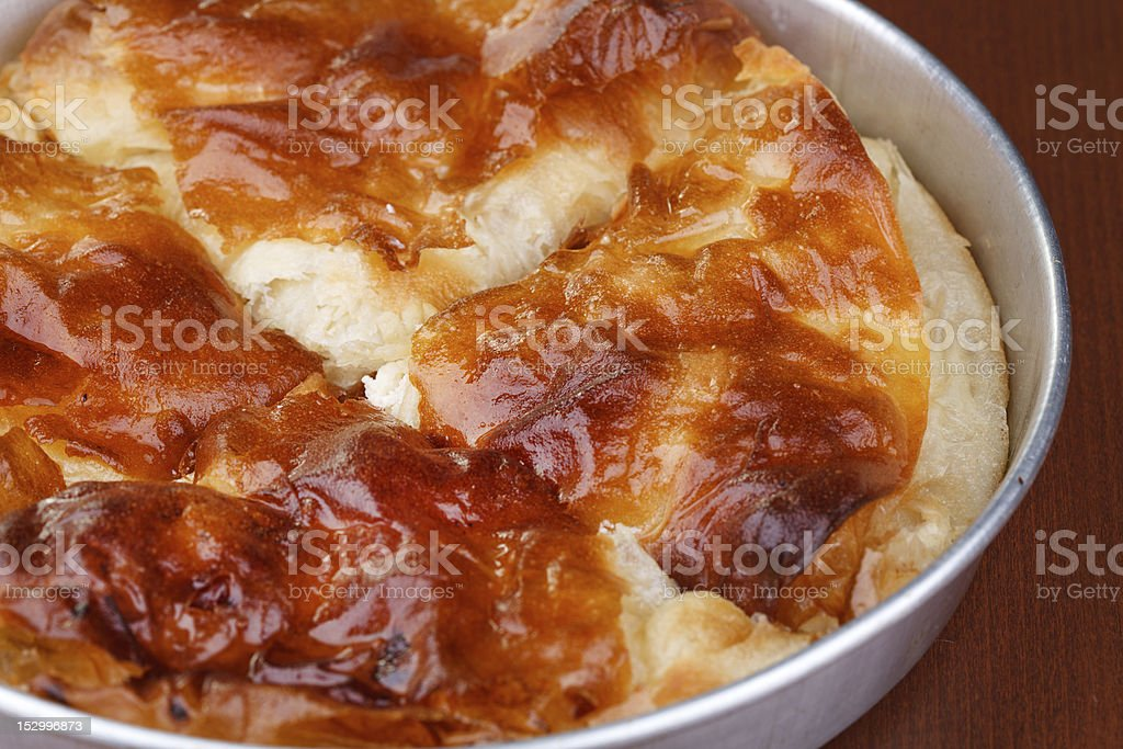Burek with cheese in casserole stock photo