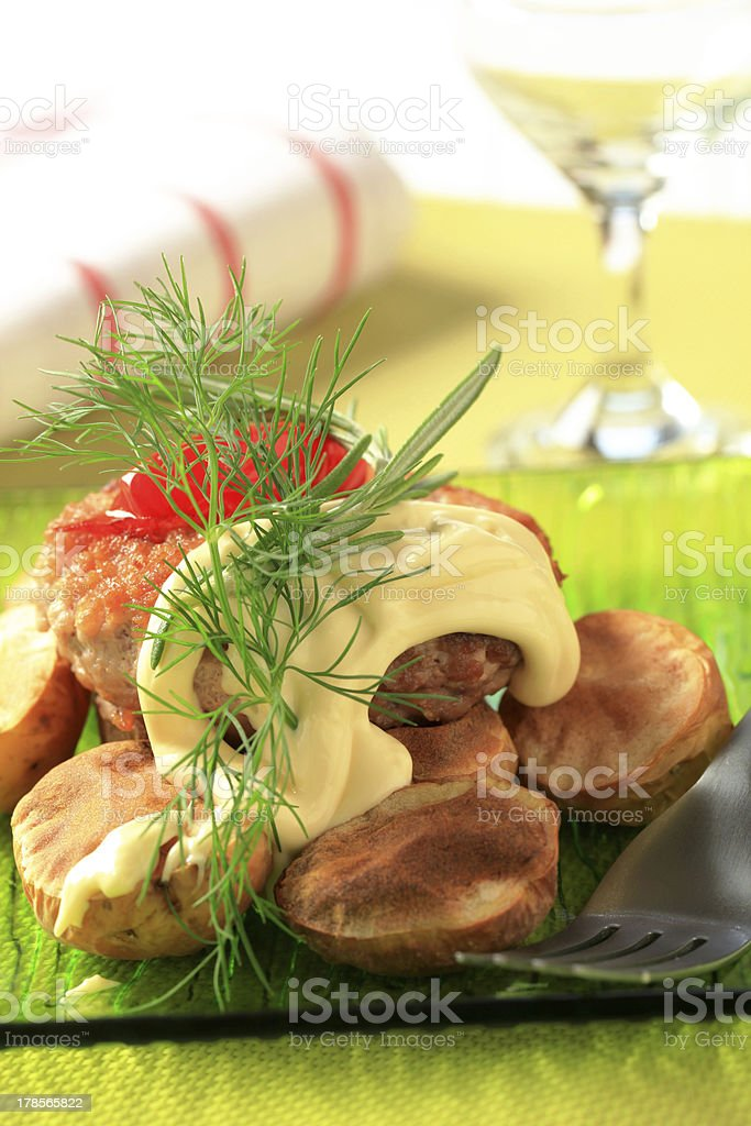 Burger and baked potatoes royalty-free stock photo