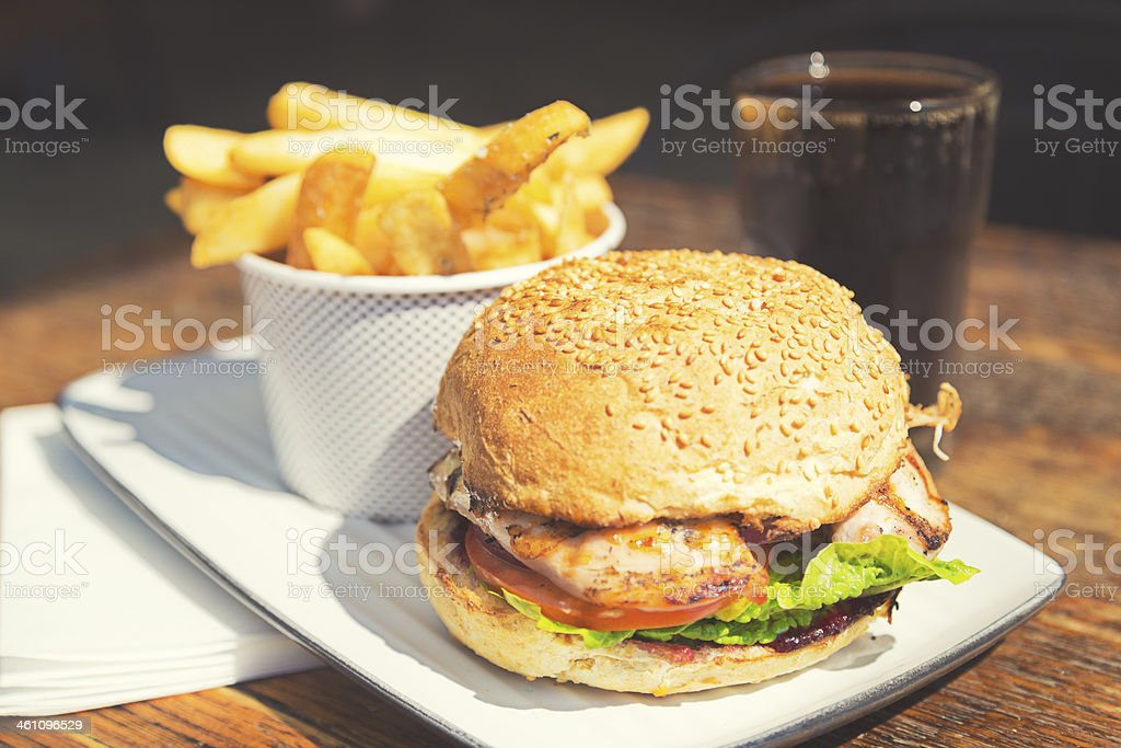 Burger and chunky chips stock photo