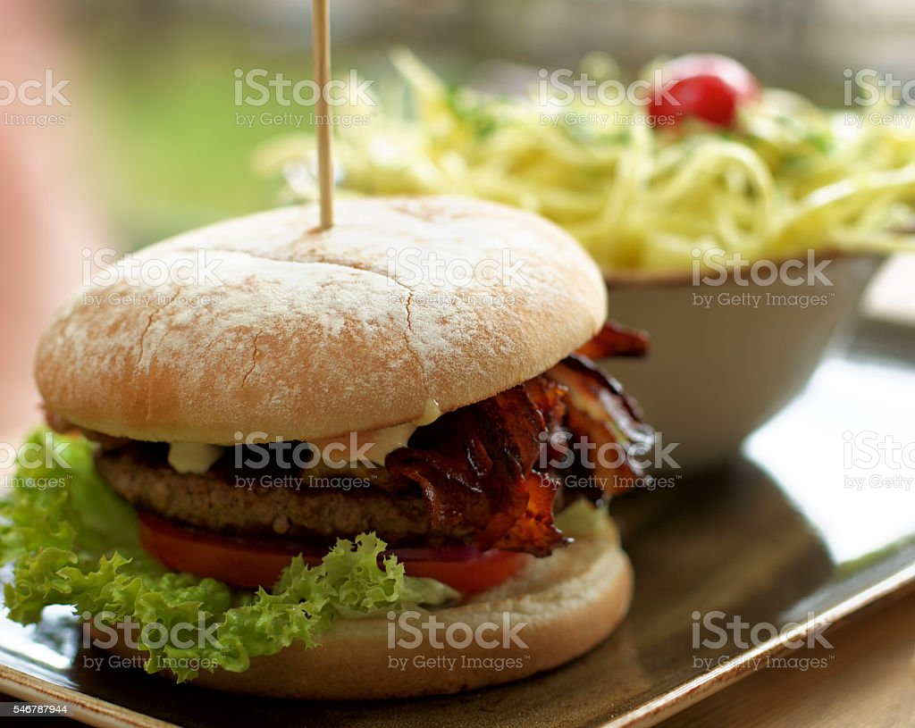 Burger and Coleslaw Salad stock photo