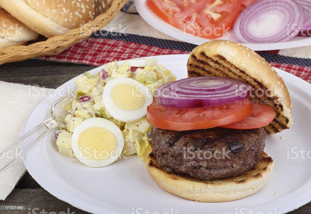 Burger and Potato Salad royalty-free stock photo