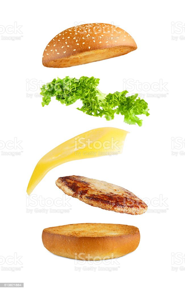Burger explosion, flying layers isolated. stock photo