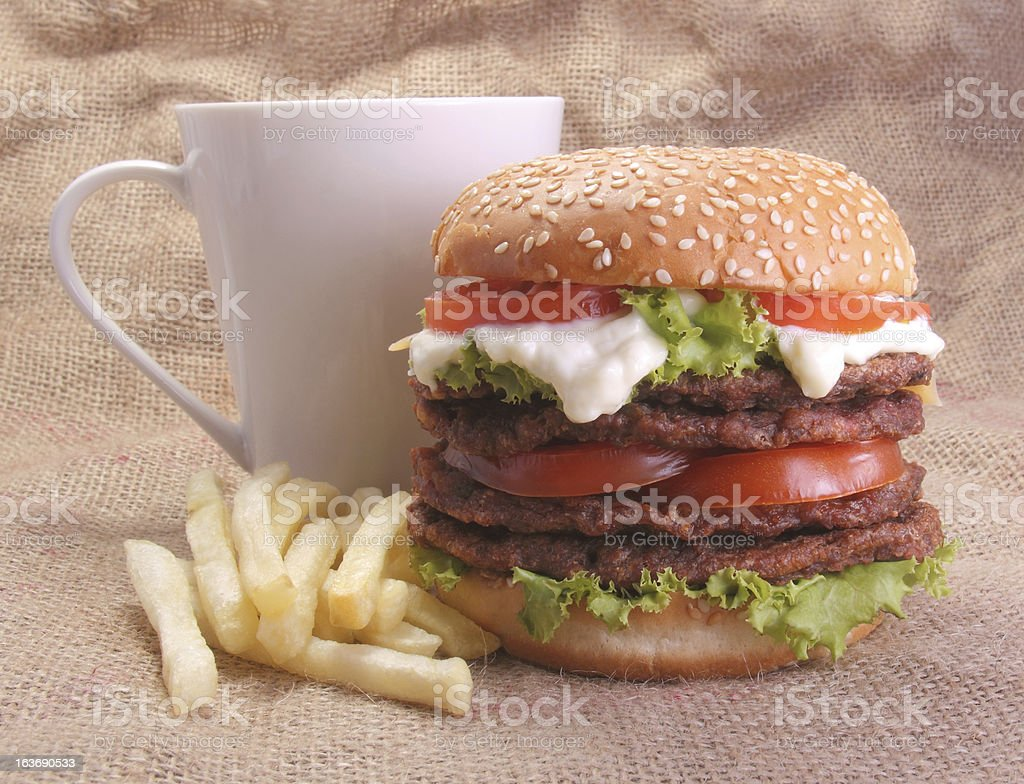Burger, french fries and cup royalty-free stock photo