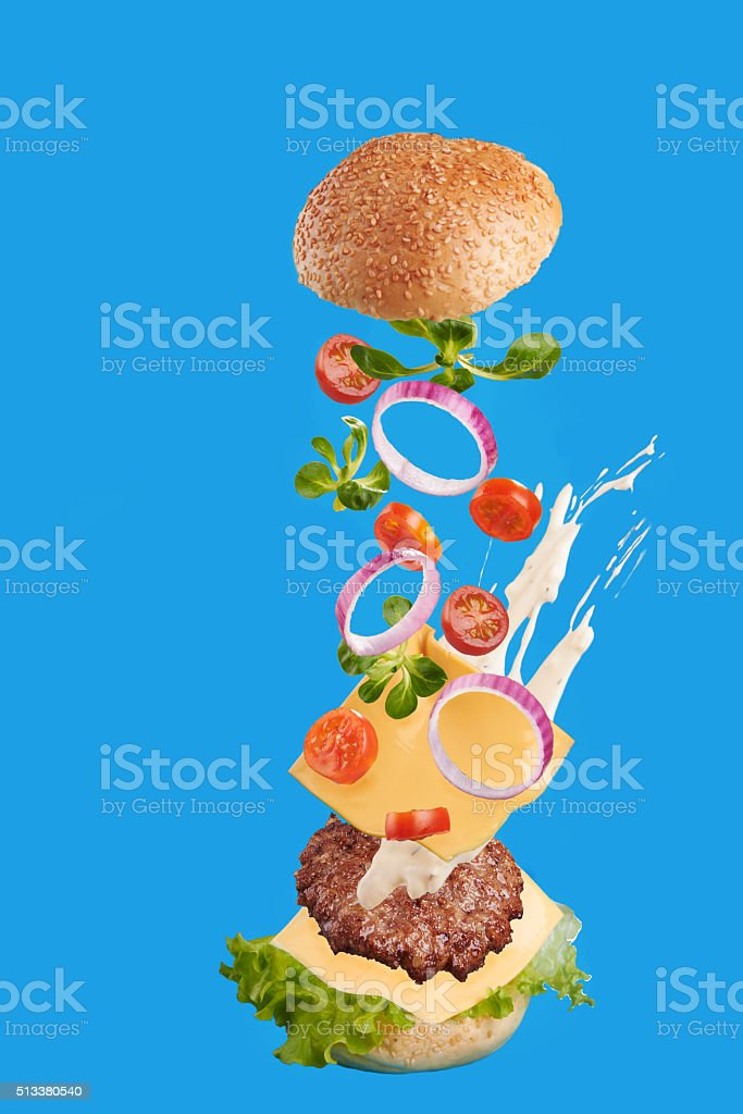 Burger in motion stock photo