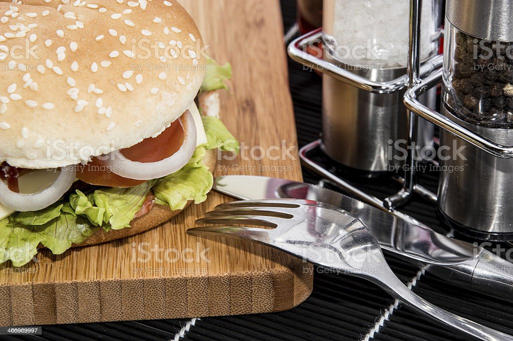 Burger on a cutting board royalty-free stock photo