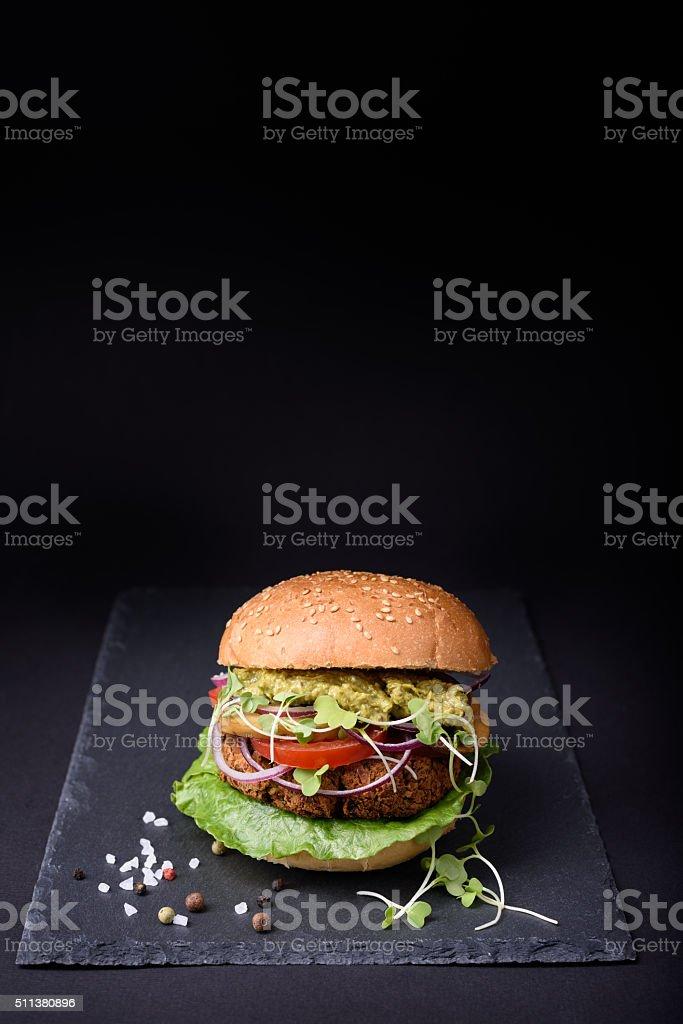 Burger on black stone board stock photo