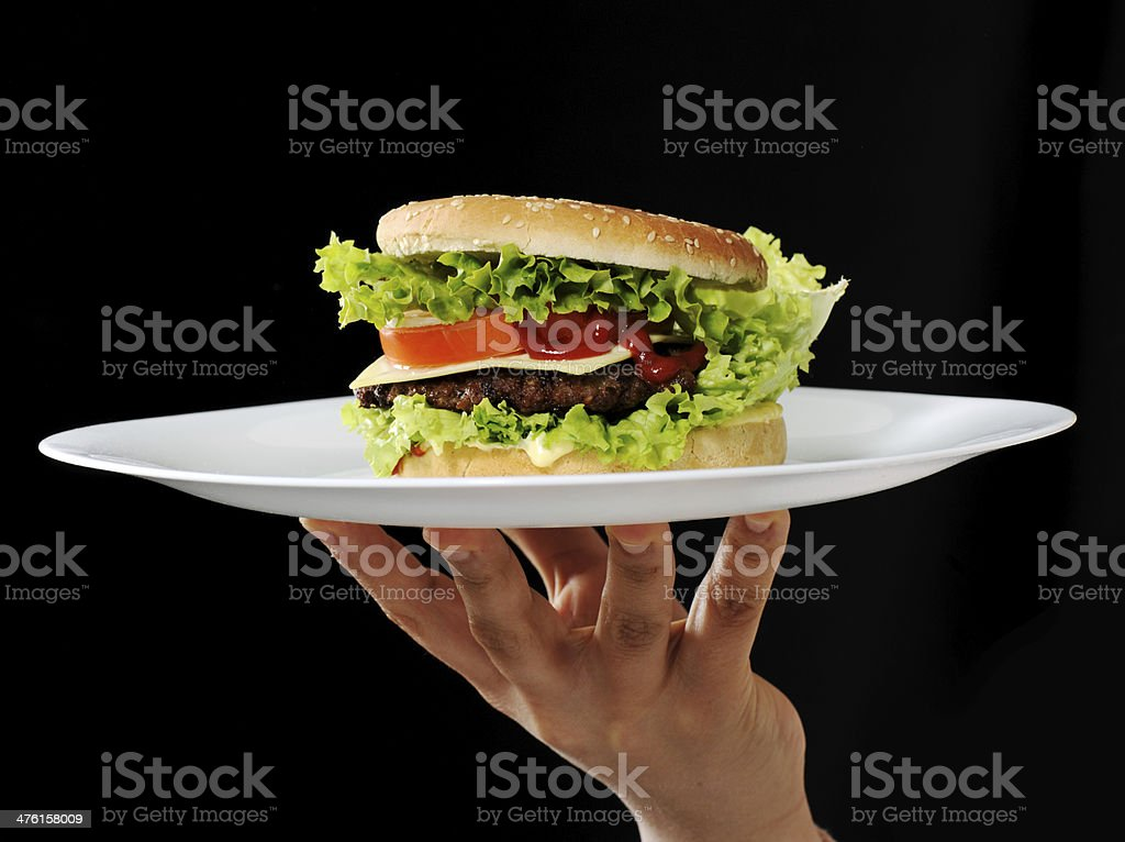 Burger on plate at restaurant royalty-free stock photo
