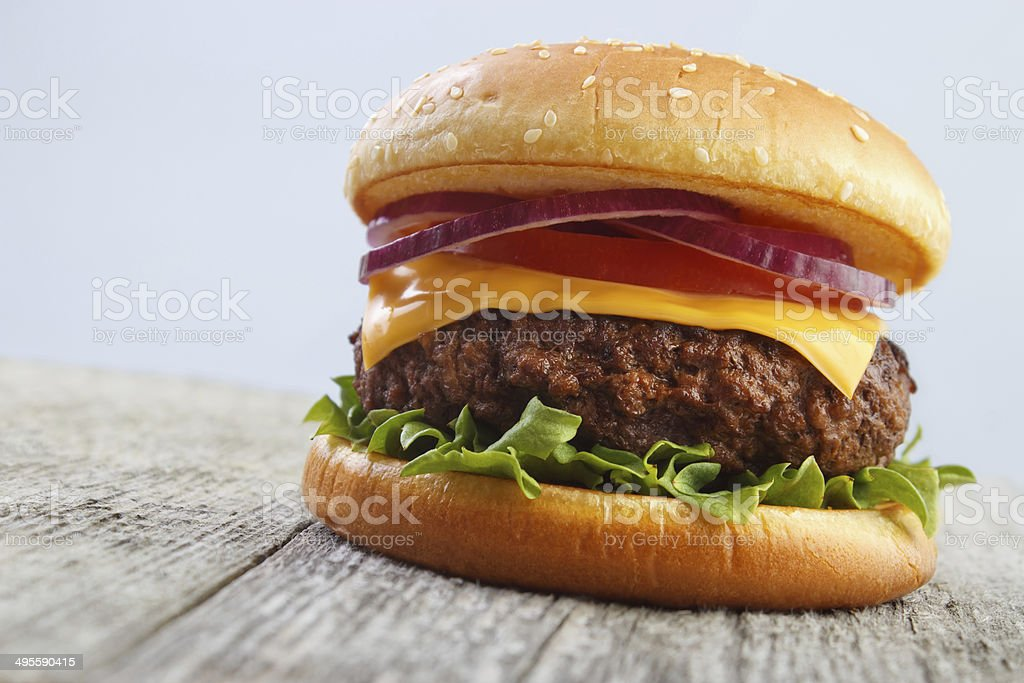 Burger on wooden board royalty-free stock photo