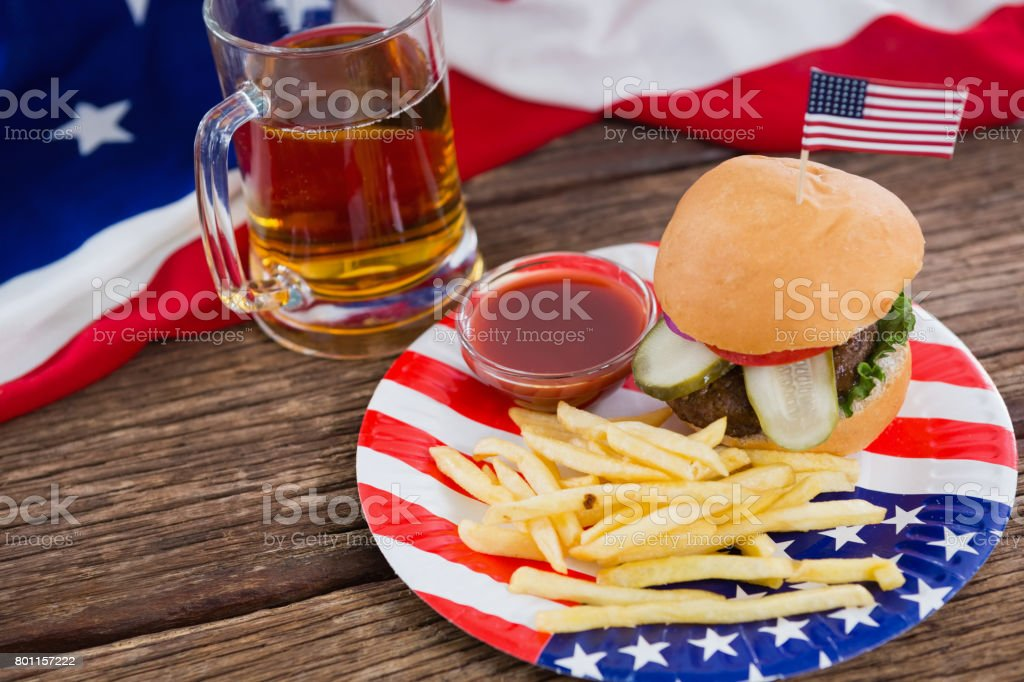 Burger on wooden table with 4th july theme stock photo