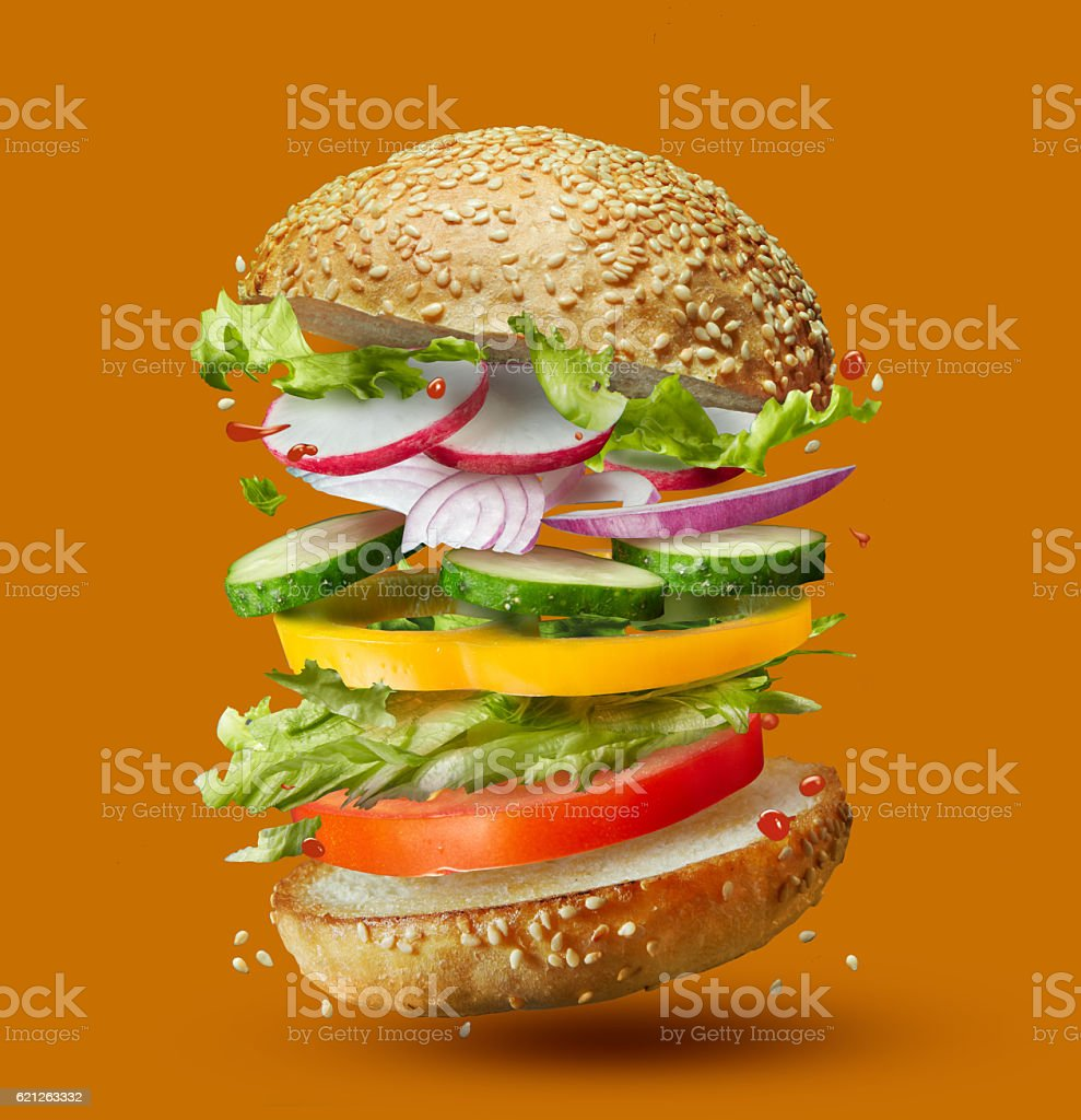 Burger preparation ingredients falling into place stock photo
