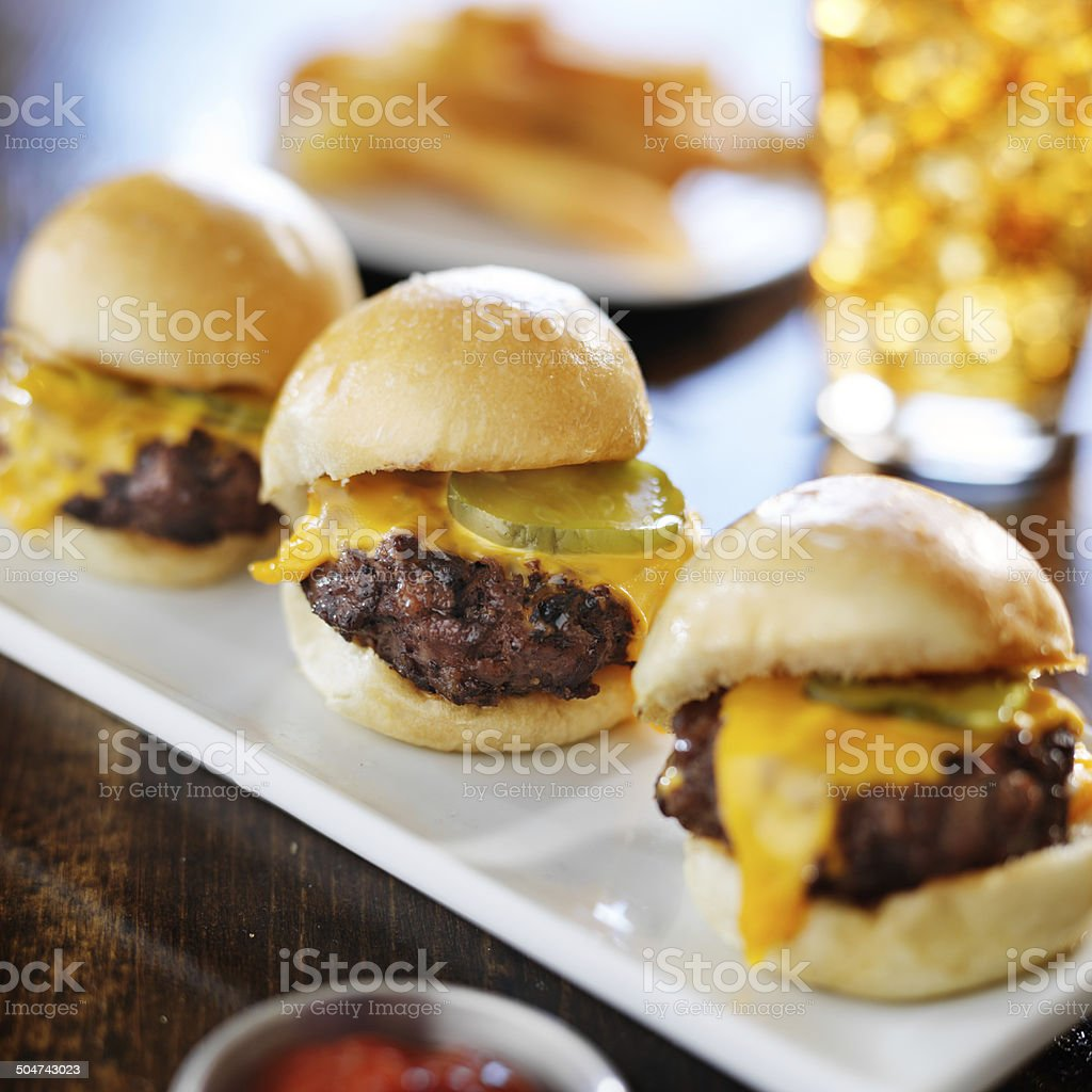 burger sliders with melted cheese and pickle stock photo