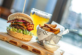 Burger with beer, potato fries and mayonaise