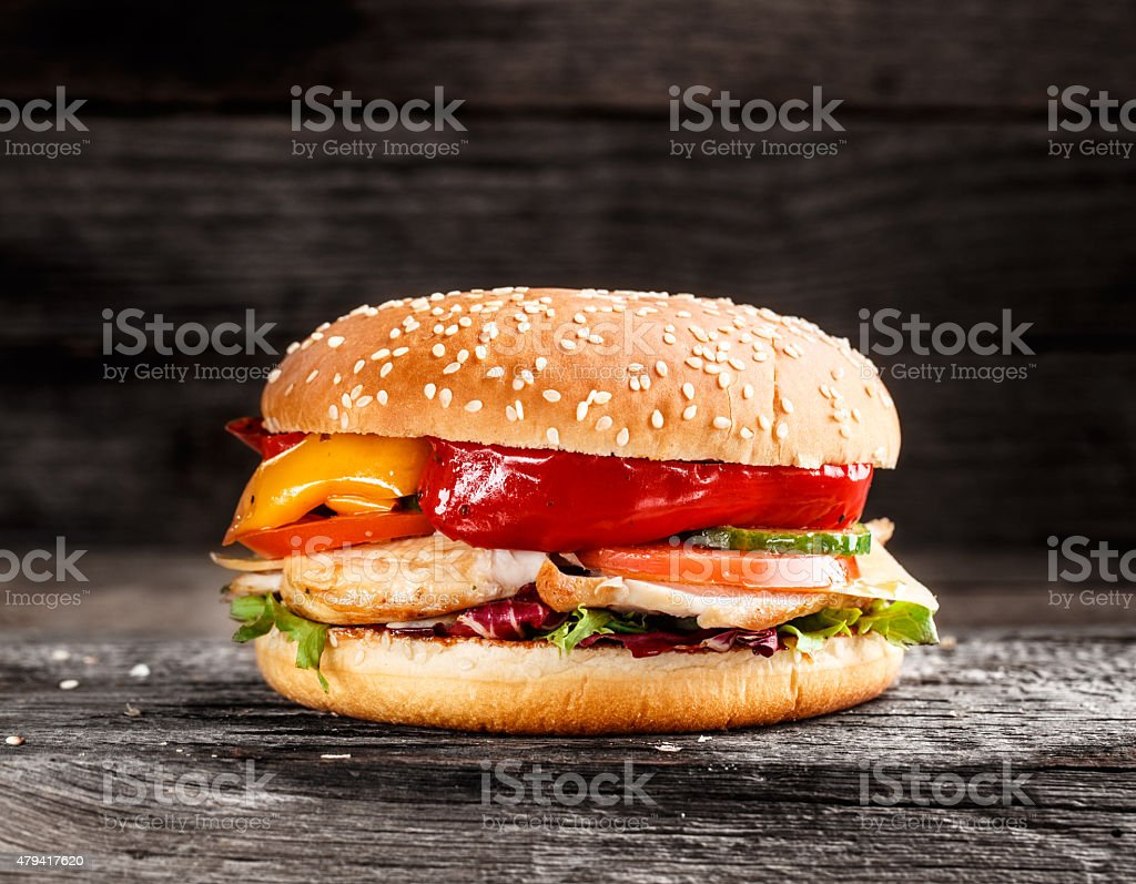 Burger with chicken and vegetables stock photo