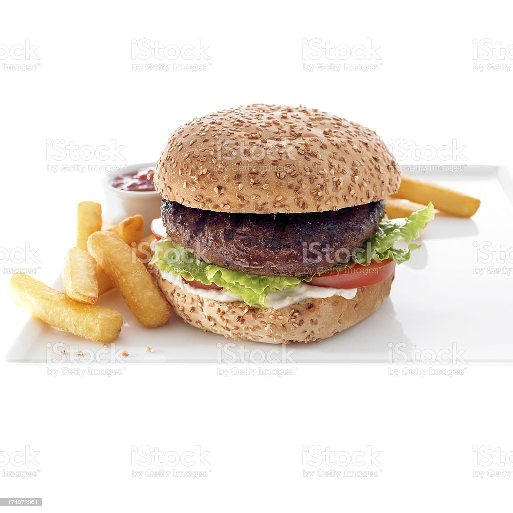 Burger with chips. Shallow focus on front. stock photo