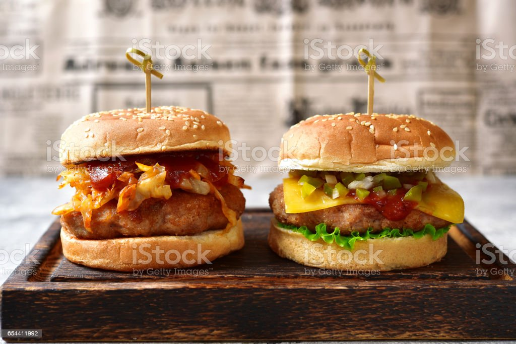 Burger with meat cutlet and fried cabbage stock photo