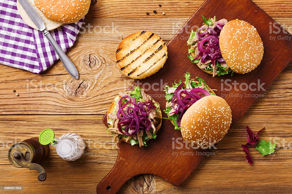 Burger with meat of duck with red onion and lettuce. stock photo