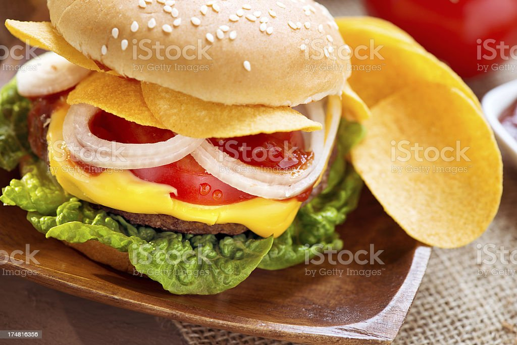 Burger with potato chips stock photo