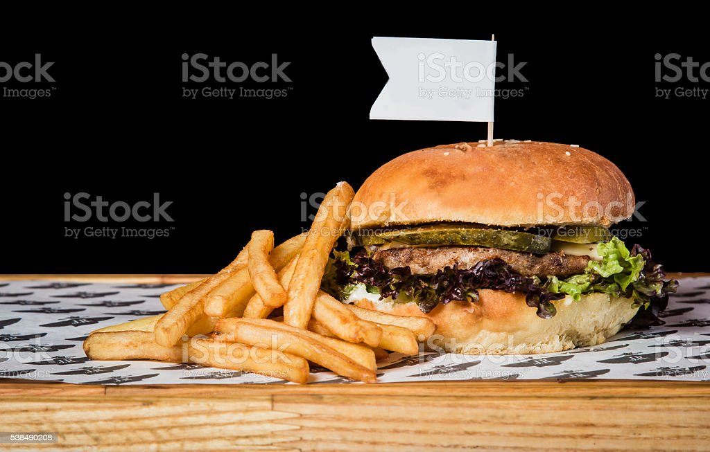 Burger with potatoes on table. stock photo