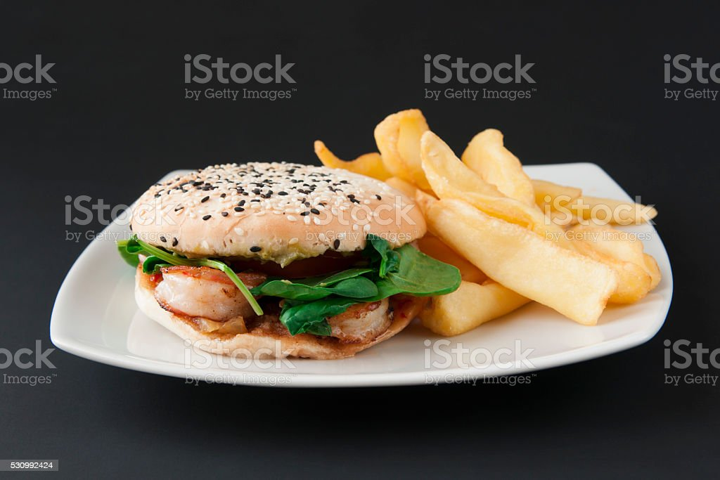 Burger with shrimp and potato fries stock photo