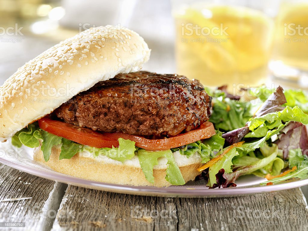 BBQ Burger with Spring Salad royalty-free stock photo