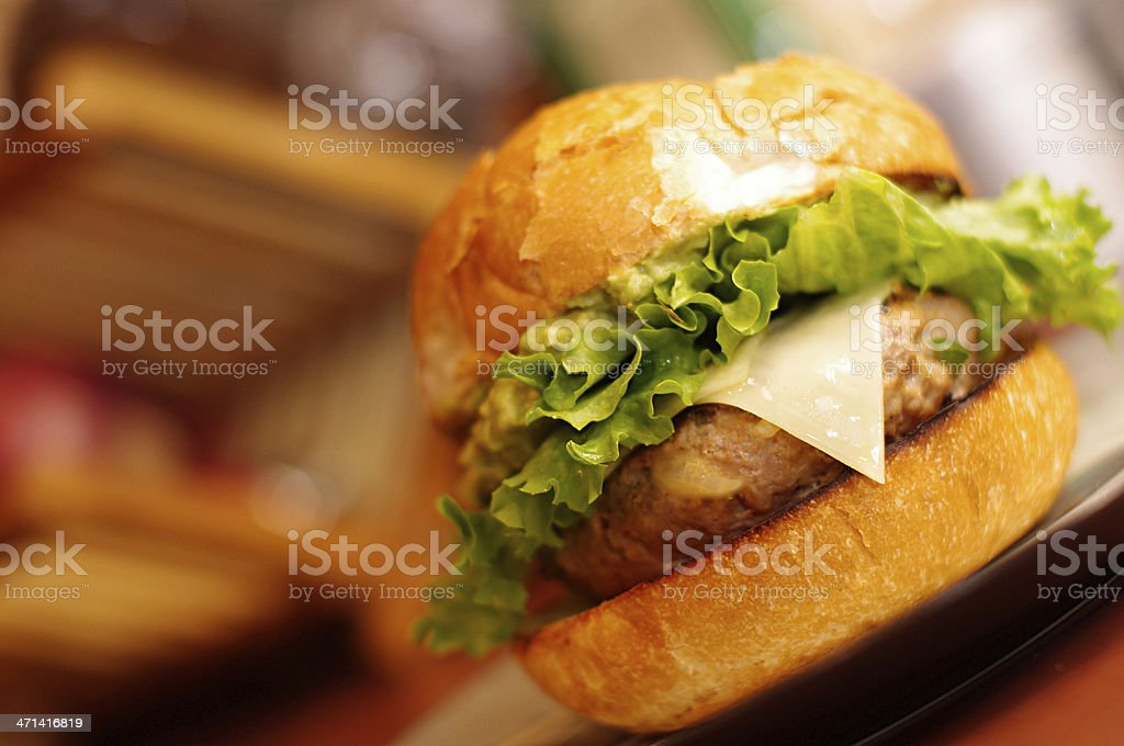 Burger with white cheddar cheese on Kaiser roll stock photo