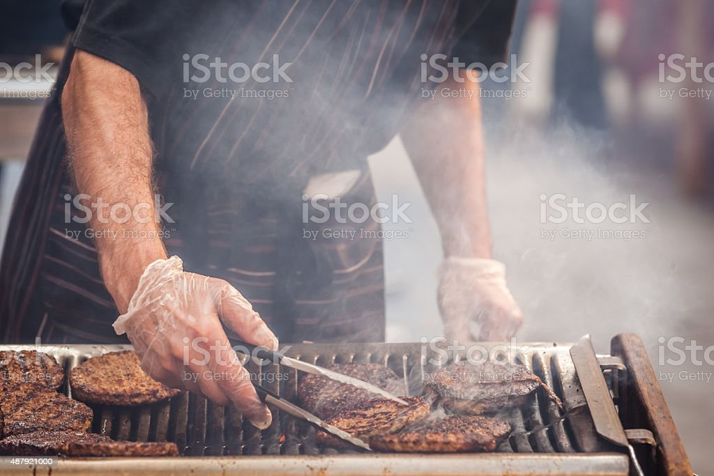 Burgers on barbecue stock photo