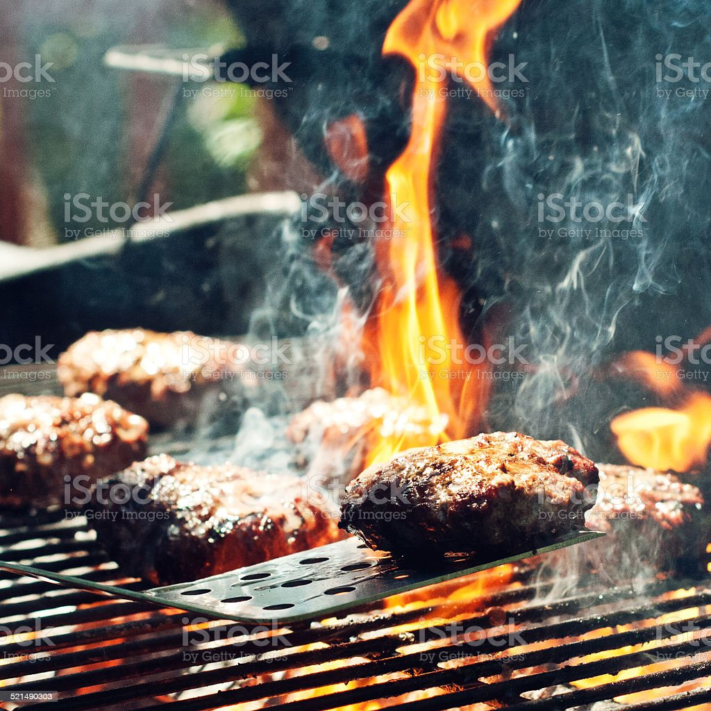Burgers on Grill royalty-free stock photo