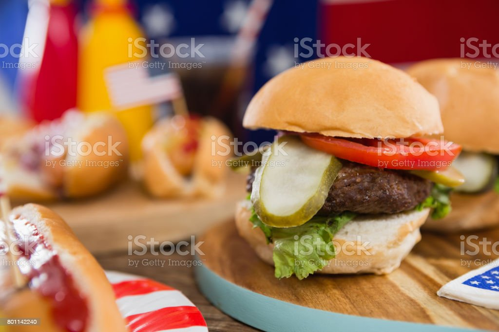 Burgers on wooden table with 4th july theme stock photo