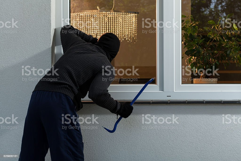 Burglar before burglary into the house stock photo