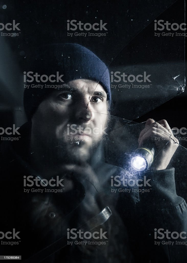 Burglar by the window royalty-free stock photo