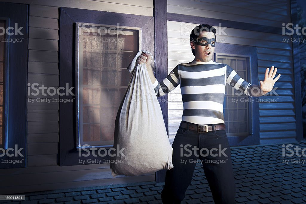 Burglar caught on the roof of a house stock photo